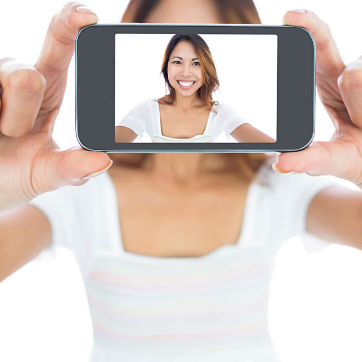 Biometric authentication by selfie