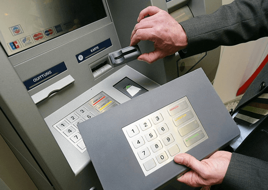 Credit card fraud with an overlay on the keypad